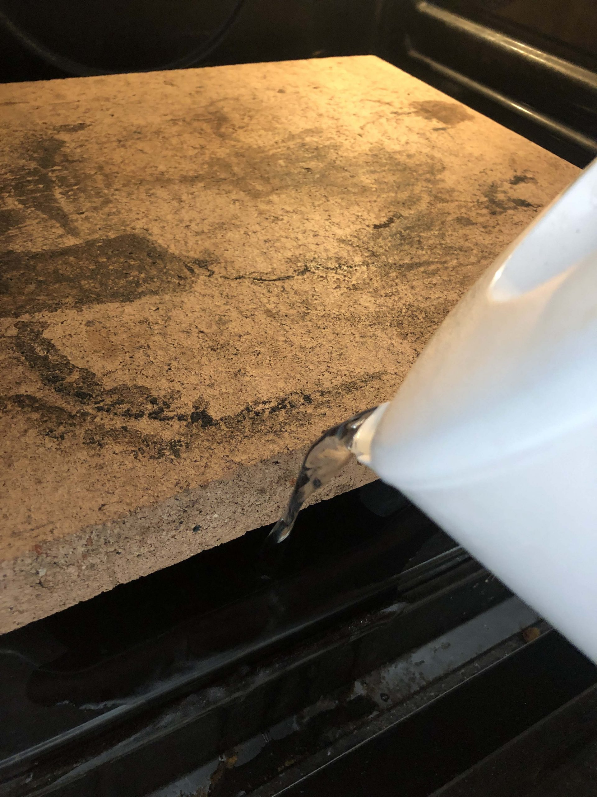 add a cup of water to a hot tray in the oven