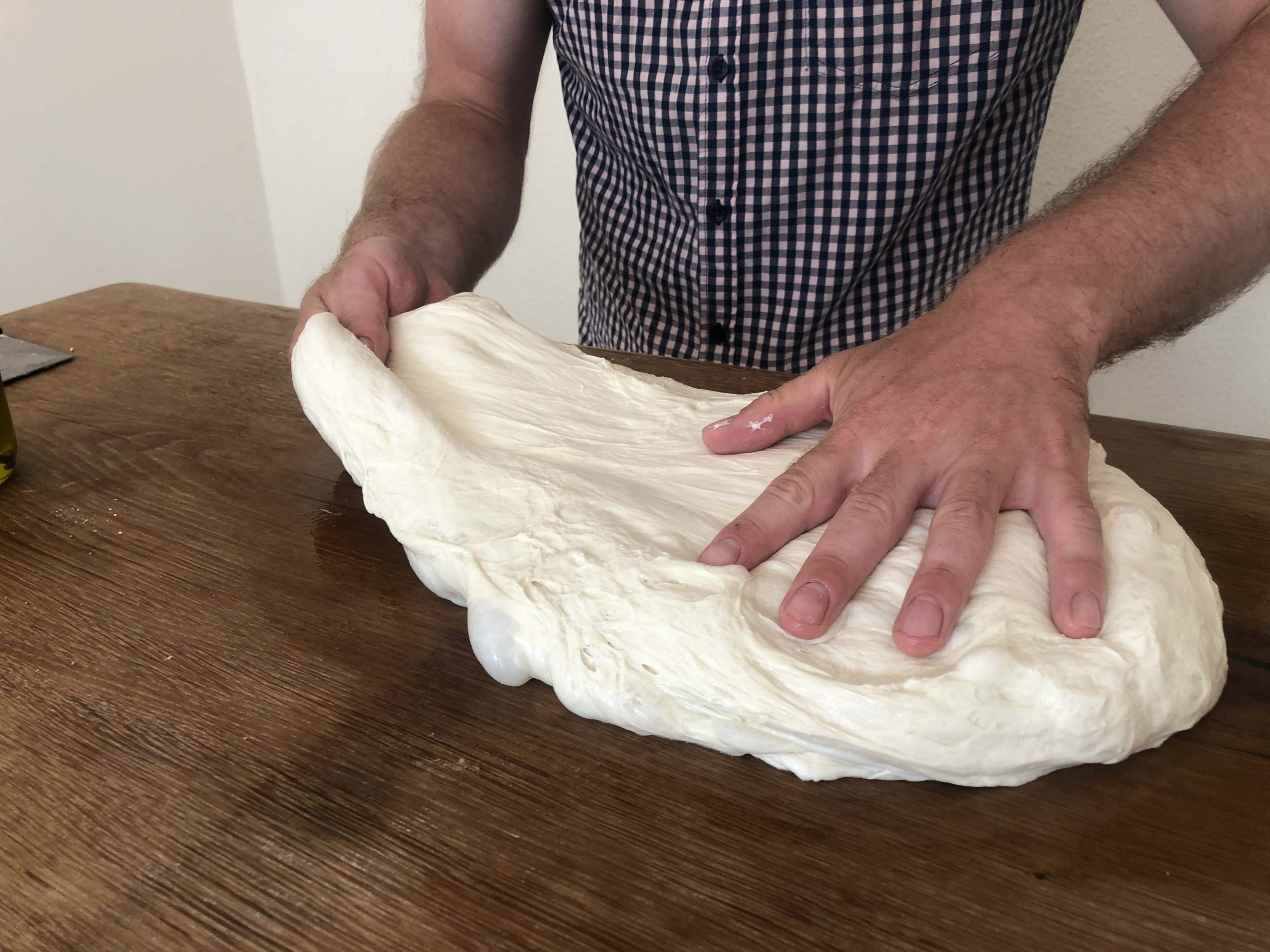 stretch one side of the dough