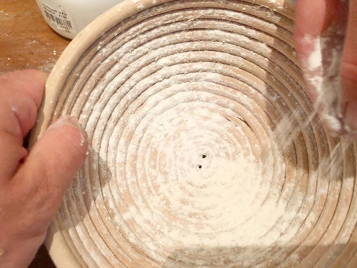 preparing a bread proofing basket