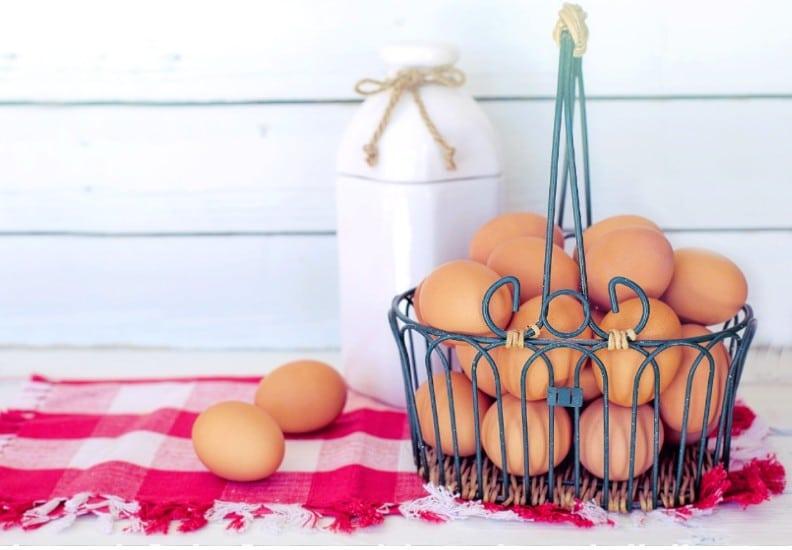 Adding eggs to bread
