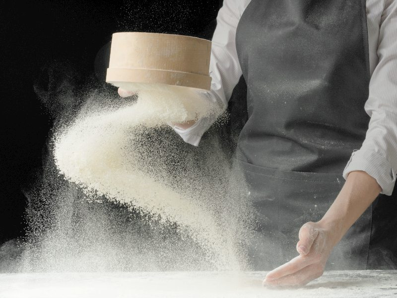 How is flour made in modern mills for bread and cakes
