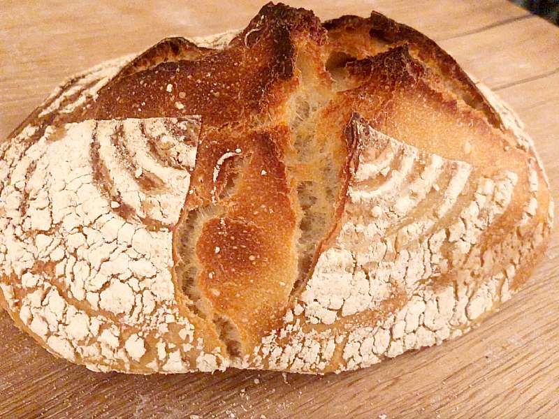 An example of ripping through the cuts of an under proofed loaf