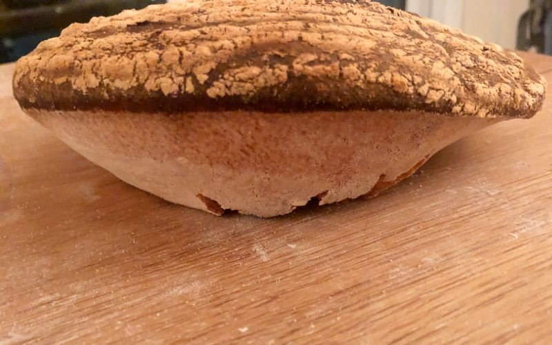 In this case the bread was too dry on the surface and gas escaped downwards.